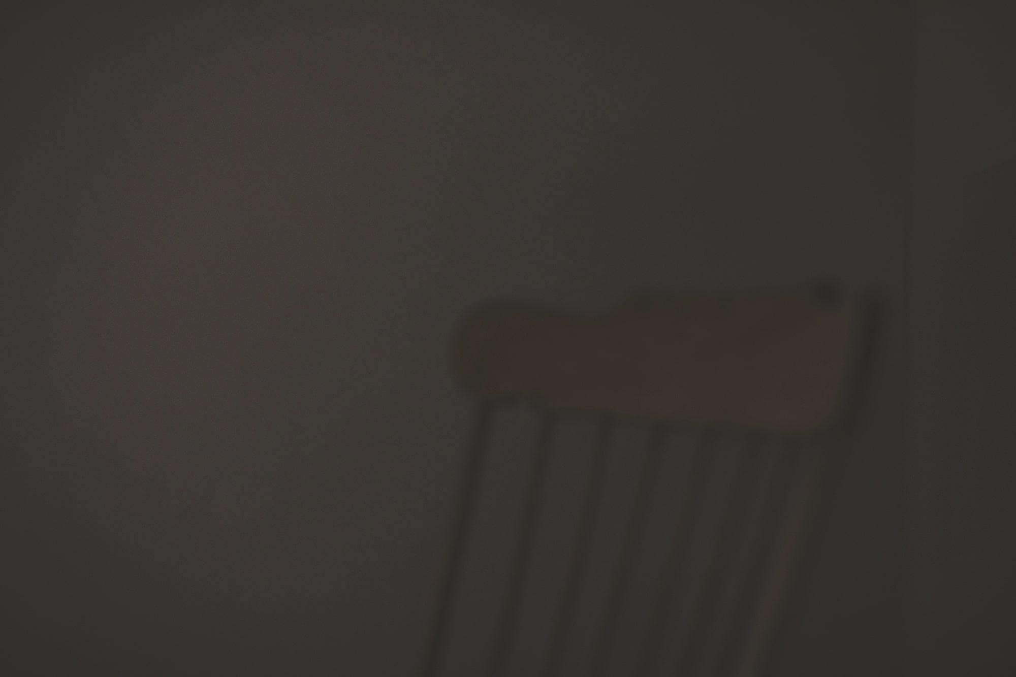 Wooden chair in dark room